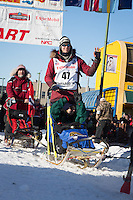 Joar Leifseth Ulsom and team leave the ceremonial start line at 4th Avenue and D street in downtown Anchorage during the 2014 Iditarod race.<br /> Photo by Jim R. Kohl/IditarodPhotos.com