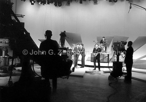 Beatles rehearse on Ed Sullivan Show at CBS studios, February 1964, New York. Photographer John G. Zimmerman