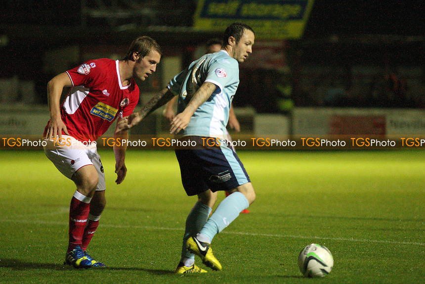 Tom Aldred of Accrington Stanley and Rhys Murphy of Dagenham and Redbridge -  Accrington Stanley vs Dagenham and Redbridge at the Crown Ground Stadium - 04/10/13 - MANDATORY CREDIT: Dave Simpson/TGSPHOTO - Self billing applies where appropriate - 0845 094 6026 - contact@tgsphoto.co.uk - NO UNPAID USE