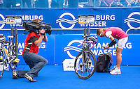 17 JUL 2011 - HAMBURG, GER - A television cameraman films Emma Snowsill (AUS) as she prepares in transition for the start of the women's Hamburg round of triathlon's ITU World Championship Series (PHOTO (C) NIGEL FARROW)