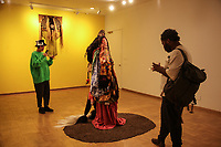 (Freelance photo by Amanda Jane Shank)<br /> <br /> Opening reception of Wanlass Artist in Residence Kenyatta A.C. Hinkle's solo exhibition Kentifrications: Convergent Truth(s) and Realities, February 8, 2018.<br /> <br /> Wanlass Artist in Residence Kenyatta A. C. Hinkle presents work from her long-term Kentifrica Project in the Weingart Gallery from February 8th - March 11th, in which she continues to explore convergent histories, truth(s), imaginings and interrogations. For the duration of the show the Weingart Gallery will be turned into a Kentifrican study and research room in which visitors can have tea, research the Kentifrican archives, read books related to Kentifrica, and view Kentifrican objects and items from the College's Special Collections. Inspired by the artist's Art Outside the Bounds field trip to The Museum of Jurassic Technology in fall 2017 and extensive conversations about amassed personal archives from prompts pertaining to personal narratives and images that haunted, challenged and provoked students, this exhibition implements interrupting the aesthetic of the didactic as a colonial tool of codifying.<br /> <br /> Sponsor: Oxy Arts, Art and Art History