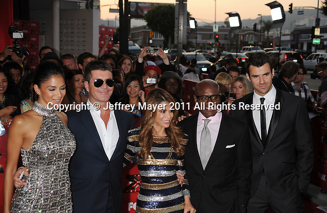 "HOLLYWOOD CA - SEPTEMBER 14: Nicole Scherzinger, Simon Cowell, Paula Abdul, Antonio ""L.A."" Reid,  and Steve Jones attend the ""The X Factor"" World Premiere Screening at ArcLight Cinemas on September 14, 2011 in Hollywood, California."