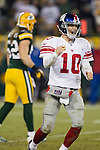 New York Giants quarterback Eli Manning (10) celebrates a touchdown pass during an NFL divisional playoff football game against the Green Bay Packers on January 15, 2012 in Green Bay, Wisconsin. The Giants won 37-20. (AP Photo/David Stluka)
