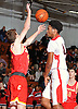 Chris Coalmon #24 of Long Island Lutheran, right, attempts to make a no-look pass during a non-league varsity boys basketball game against Chaminade at Long Island Lutheran High School on Friday, Dec. 16, 2016.