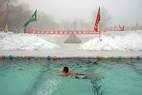 On the last day of my tour of Urumqi, the capital city for China's Xinjiang Uyghur Autonomous Region, we stopped at a local pool where a group of Chinese men gather to swim outdoors in the bitter cold of the long winter.