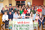 The people of Kilcummin welcome home cyclists David Fleming, Kieran Lynch and their driver Michael Fleming all seated centre after they finished their 737 mile Cycle Challenge in aid of the Irish Cancer Society in the Kilcummin GAA clubhouse Tuesday night    Copyright Kerry's Eye 2008