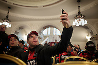 Cadel Evans (AUS/BMC) taking a selfie while waiting for his team to hit the stage<br /> <br /> <br /> Giro d'Italia 2014<br /> Opening Ceremony
