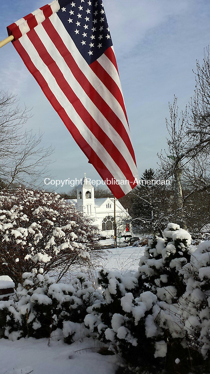 WATERTOWN, CT-12 December 2013-121213LW03 - A flag flies from the Board of Education headquarters at the Munson House in Watertown after the first snow of the season.<br /> Laraine Weschler Republican-American