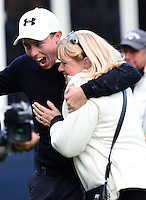 Matthew Fitzpatrick of England celebrates on the 18th green with Mother Susan following his victory during Round 4 of the 2015 British Masters at the Marquess Course, Woburn, in Bedfordshire, England on 11/10/15.<br /> Picture: Richard Martin-Roberts | Golffile