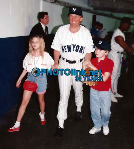 CelebrityArchaeology.com<br /> 1992 FILE PHOTO<br /> Donald Trump with Eric and Ivanka<br /> Photo By John Barrett-PHOTOlink.net<br /> -----<br /> CelebrityArchaeology.com, a division of PHOTOlink,<br /> preserving the art and cultural heritage of celebrity<br /> photography from decades past for the historical<br /> benefit of future generations, for these images are<br /> significant, both historically and aesthetically.<br /> ——<br /> Follow us:<br /> www.linkedin.com/in/adamscull<br /> Instagram: CelebrityArchaeology<br /> Blog: CelebrityArchaeology.info<br /> Twitter: celebarcheology