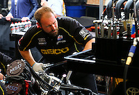 Mar 29, 2014; Las Vegas, NV, USA; A crew member works on the car of NHRA top fuel driver Richie Crampton during qualifying for the Summitracing.com Nationals at The Strip at Las Vegas Motor Speedway. Mandatory Credit: Mark J. Rebilas-