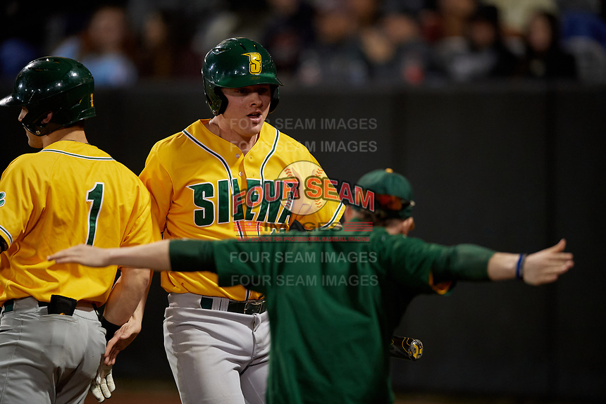Siena Saints Pat O'Hare (17) celebrates a run with teammates during a game against the UCF Knights on February 14, 2020 at John Euliano Park in Orlando, Florida.  UCF defeated Siena 2-1.  (Mike Janes/Four Seam Images)