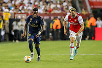 Landover, MD - July 23, 2019: Real Madrid Vinicius Junior (28) steals the ball from Arsenal Sead Kolasinac (31) during the match between Arsenal and Real Madrid at FedEx Field in Landover, MD.   (Photo by Elliott Brown/Media Images International)