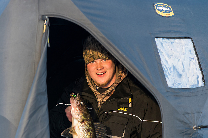 An ice fisherman shows off a walleye caught while fishing on Little Bay de Noc near Gladstone and Escanaba, Michigan.