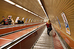 Commuters ride the quick, long escalators into a Prague Metro station, Prague, Czech Republic, Europe