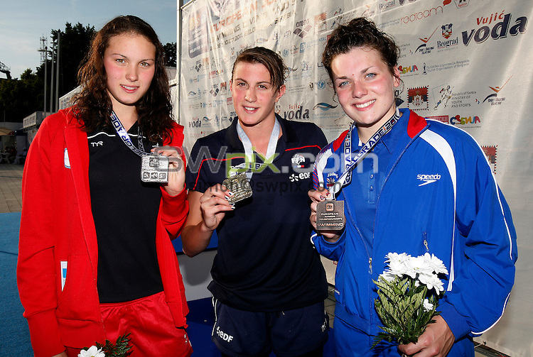 PICTURE BY VAUGHN RIDLEY/SWPIX.COM...Swimming - European Junior Swimming Championships 2011- Tasmajdan Swim Centre, Belgrade, Serbia - 10/07/11...Girls 100m Freestyle Final - L-R - Silver - Denmark's Mie OE Nielsen, Gold - France's Charlotte Bonnet, Bronze - Great Britain's Jessica Lloyd.