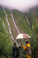 """Film-maker Paul Atkins with Dr. Steve Montgomery at """"""""Blue Hole"""""""", below Mt. Waialeale, headwaters of Wailua River, during filming of Nat. Geo. Special Strangers in Paradise."""