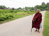 An elderly Buddhist Monk on his way back to his Monastery outside Mrauk U Town, Rakhine State, Myanmar