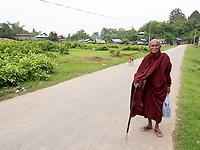 An elderly Buddhist Monk on his way back to his Monastery outside Mrauk U Town, Rakhine State, Myanmar