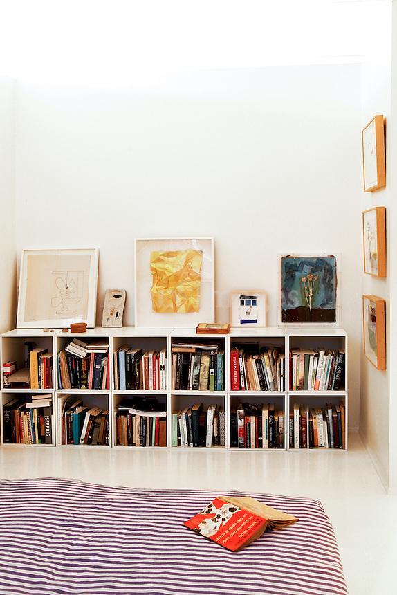 modern bedroom with bookshelf