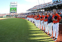 Virginia Head Coach Brian O'Connor and the Cavaliers stand during the National Anthem. Virginia beat Cal 8-1 at the College World Series on June 23, 2011 in Omaha, Neb. (Photo by Michelle Bishop)..