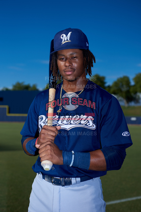 AZL Brewers Blue Orveo Saint (30) poses for a photo before an Arizona League game against the AZL Brewers Gold on July 13, 2019 at American Family Fields of Phoenix in Phoenix, Arizona. The AZL Brewers Blue defeated the AZL Brewers Gold 6-0. (Zachary Lucy/Four Seam Images)