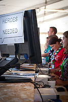 IST Information desk with sign heroes needed. Photo: André Jörg/ Scouterna