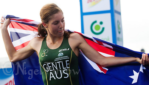 12 SEP 2010 - BUDAPEST, HUN - Ashleigh Gentle wraps the Australian flag around her shoulders after winning the 2010 ITU Junior Womens World Championships (PHOTO (C) NIGEL FARROW)