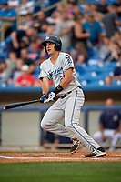 West Michigan Whitecaps third baseman Daniel Pinero (21) follows through on a swing during the second game of a doubleheader against the Lake County Captains on August 6, 2017 at Classic Park in Eastlake, Ohio.  West Michigan defeated Lake County 9-0.  (Mike Janes/Four Seam Images)