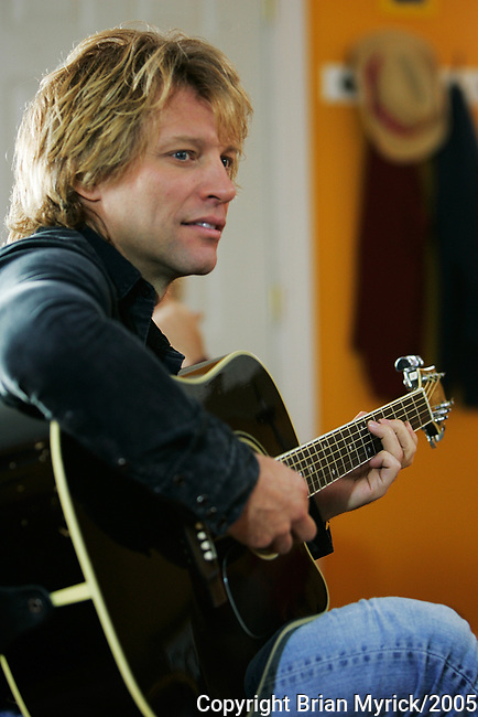 Jon Bon Jovi performs during the shooting of a Bon Jovi music video being shot at a Habitat for Humanity build site in north Philadelphia, Tuesday, October 25, 2005.(Brian Myrick)