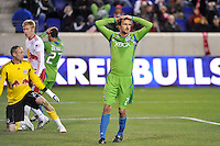 Roger Levesque (24) of the Seattle Sounders reacts to a missed scoring opportunity during the second half against the New York Red Bulls The New York Red Bulls defeated the Seattle Sounders 1-0 during a Major League Soccer (MLS) match at Red Bull Arena in Harrison, NJ, on March 19, 2011.