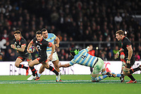 Alex Lozowski of England accelerates past Matias Alemanno of Argentina during the Old Mutual Wealth Series match between England and Argentina at Twickenham Stadium on Saturday 11th November 2017 (Photo by Rob Munro/Stewart Communications)