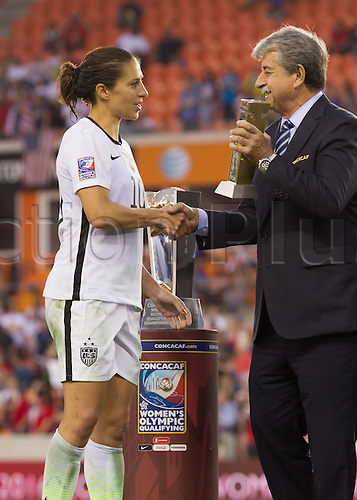 21.02.2016. Houston, TX, USA.  USA Midfielder Carli Lloyd (10) accepts the Team Fair Play award during the Women's Olympic qualifying soccer final match between Canada and USA at BBVA Compass Stadium in Houston, Texas.