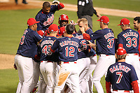 Memphis Redbirds catcher Tony Cruz #18 is mobbed by teammates after Cruz hit a walk off single during a game versus the Round Rock Express at Autozone Park on April 28, 2011 in Memphis, Tennessee.  Memphis defeated Round Rock by the score of 6-5 in ten innings.  Photo By Mike Janes/Four Seam Images