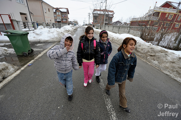 Students walk home from their preschool for Roma children in the Zemun Polje neighborhood of Belgrade, Serbia. The program, for children 5-9 years old, is part of the Branko Pesic School, supported by Church World Service.  Many of the children are from refugee families that fled from Kosovo. Lacking legal legal status in Serbia, their children are unable to attend regular schools.