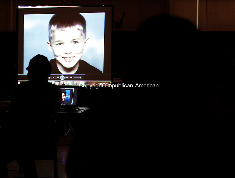 Waterbury, CT- 23, September 2011-092411CM02  A picture of Daniel Schruggs is displayed during a presentation depicting children who committed suicide after being bullied, during an anti-bullying rally at the PAL Campus in Waterbury Saturday afternoon.  Schruggs, a 12 year old Meriden boy, hanged himself in his closet in 2003.  Christopher Massa Republican-American