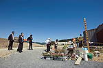 People offer prayer at a temporary shrine erected to commemorate the 74 elementary school students and children killed in the March 11 tsunami outside Okawa elementary school in Ishinomaki  City, Miyagi Prefecture, Japan on 08 Sept. 2011.  Photograph: Robert Gilhooly