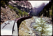 Freight cars in Animas Canyon at Needleton tank.<br /> D&amp;RGW  Needleton, CO