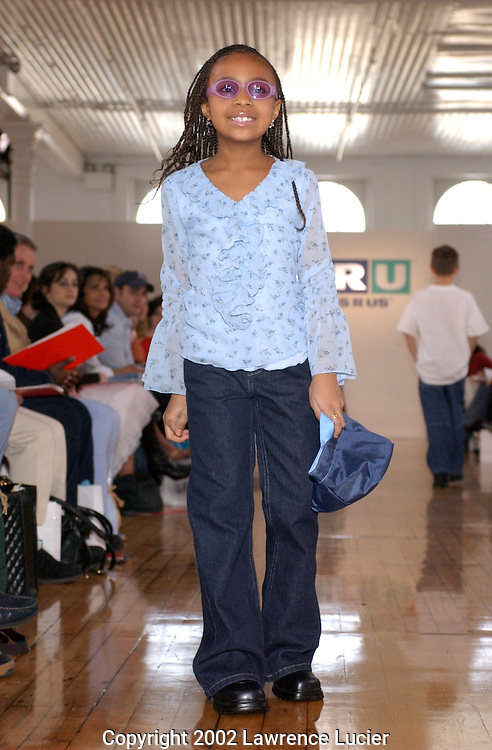 Model Heavyn Jackson, (daughter of NY Knicks Marc Jackson) wears a light blue floral peasant top and dark denim low-rise jean   April 11, 2002, in New York. These items are part of the Fall 2002 Kids R Us fashion collection..