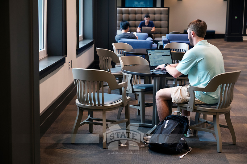Old Main Academic Center - first day of classes.  Students in between classes: Mechanical Engineering major Chase Clinard with laptop at table.<br />  (photo by Megan Bean / &copy; Mississippi State University)