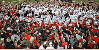 Students gather around the Buckeye football team to watch them practice at the Woody Hayes Athletic Center on April 11, 2015. Students were invited to the facility for the fourth annual Student Appreciation Practice .  (Chris Russell/Dispatch Photo)