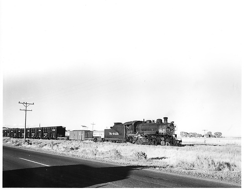 D&amp;RGW #1167 with a standard gauge freight consist containing a narrow gauge boxcar intermixed using idler cars on a dual gauge track.<br /> D&amp;RGW  Alamosa-Antonito, CO  1955
