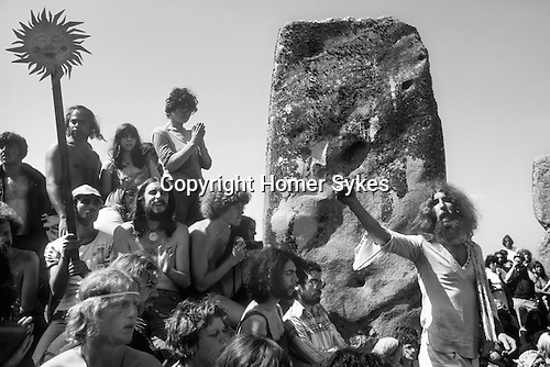 Stonehenge, Wiltshire. 1979 <br /> Hippies gather at Stonehenge to celebrate the summer solstice. John Pendragon a much revered poet, songsmith and editor of Tribal Messenger magazine  extolling the virtues of an alternative life style. He died in 1998 aged 59yrs.