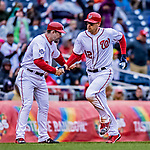 15 April 2018: Washington Nationals catcher Matt Wieters rounds the bases and gets a handshake from third base coach Bob Henley after hitting a solo home run in the 6th inning against the Colorado Rockies at Nationals Park in Washington, DC. All MLB players wore Number 42 to commemorate the life of Jackie Robinson and to celebrate Black Heritage Day in pro baseball. The Rockies edged out the Nationals 6-5 to take the final game of their 4-game series. Mandatory Credit: Ed Wolfstein Photo *** RAW (NEF) Image File Available ***