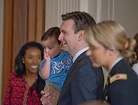 Washington DC, July 21 2016, USA- White House Press Secretary, Josh Earnest holds his son, Walker while President Barack Obama welcomes the Kansas City Royals to the White House to honor the team and their 2015 World Series victory. This visit will continue the tradition begun by President Obama of honoring sports teams for their efforts to give back to their communities.  Patsy Lynch/MediaPunch