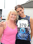 Last years first lady home Nuala Reilly and Lucy Darcy this years winner at the Newtown Blues 12.5K run. Photo:Colin Bell/pressphotos.ie