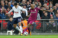 Fabian Delph of Manchester City and Erik Lamela of Tottenham Hotspur during Tottenham Hotspur vs Manchester City, Premier League Football at Wembley Stadium on 14th April 2018