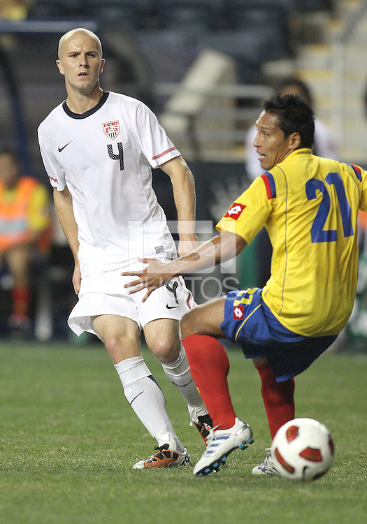 Michael Bradley #4 of the USA MNT slips the ball past John Javier Restrepo #21 of Colombia during an international friendly match at PPL Park, on October 12 2010 in Chester, PA. The game ended in a 0-0 tie.