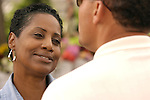 African american woman smiling and listening earnestly to her partner