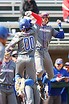 CARY, NC - MARCH 04: UMass Lowell's Steve Passatempo (00) celebrates his home run with a teammate on the bench. The University of Massachusetts Lowell River Hawks played the University of Notre Dame Fighting Irish on March 4, 2017, at USA Baseball NTC Stadium Field in Cary, NC in a Division I College Baseball game, and part of the Irish Classic tournament. UMass Lowell won the game 8-0.